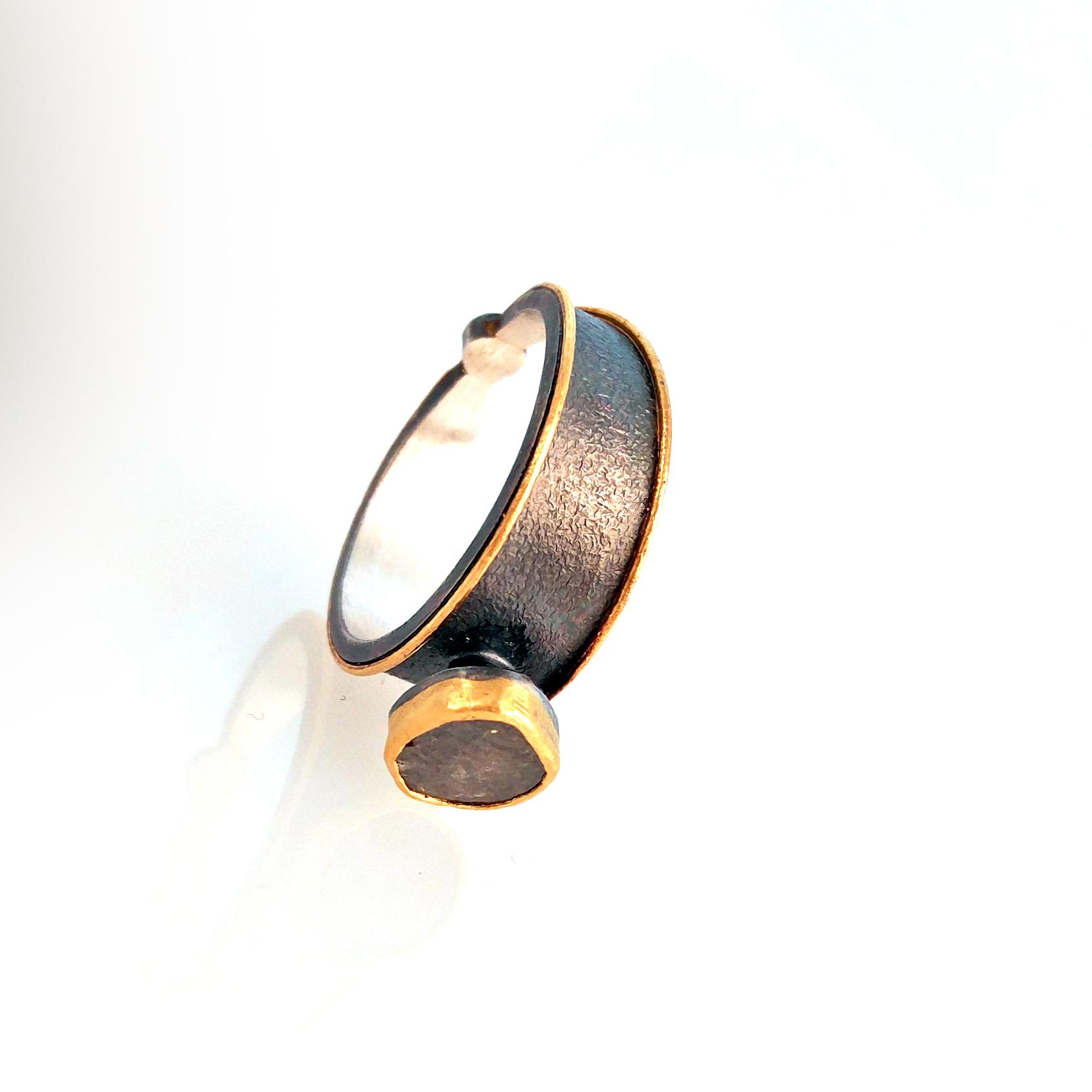 diamond ring with small yellow diamond