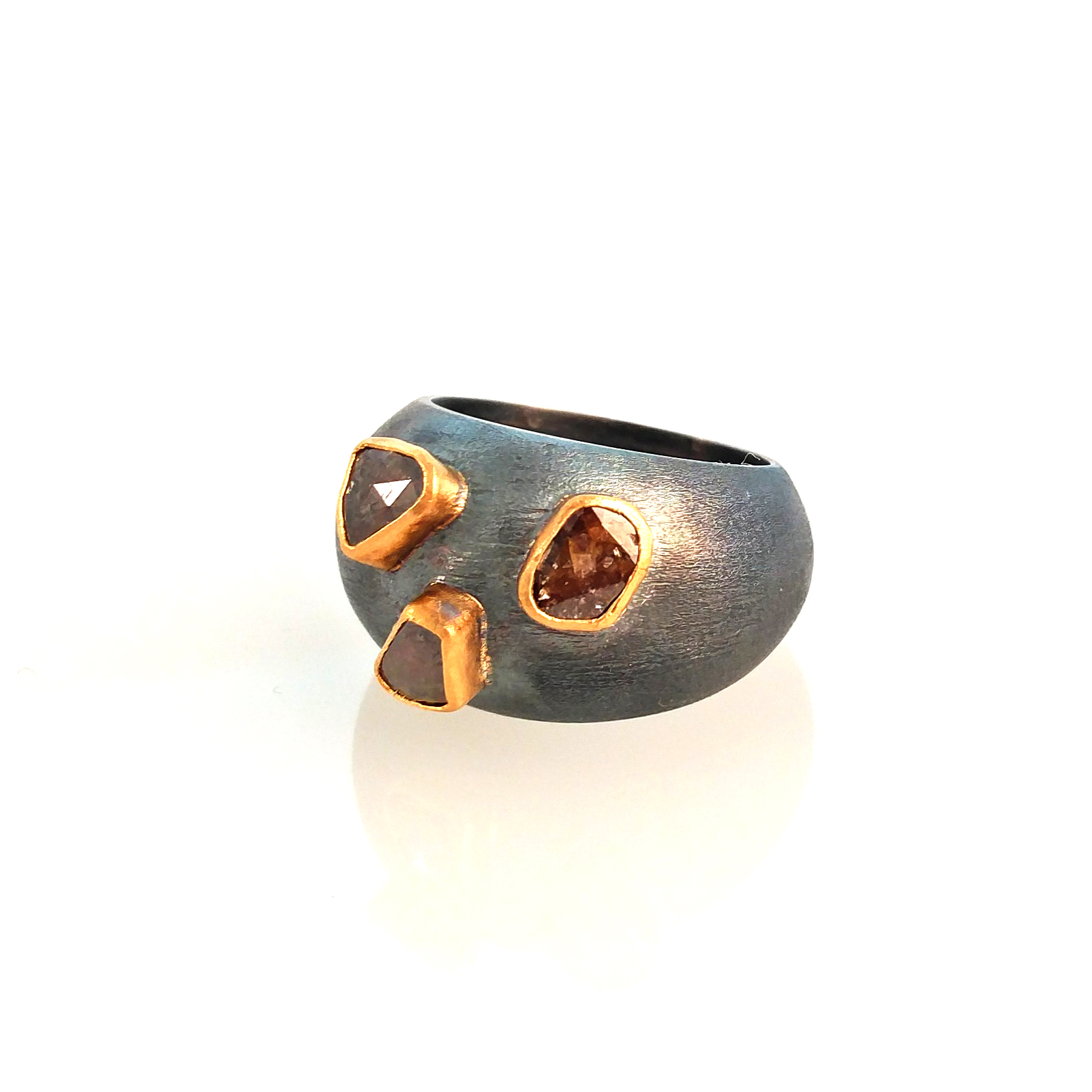 hand made 24k gold and silver ring with diamond