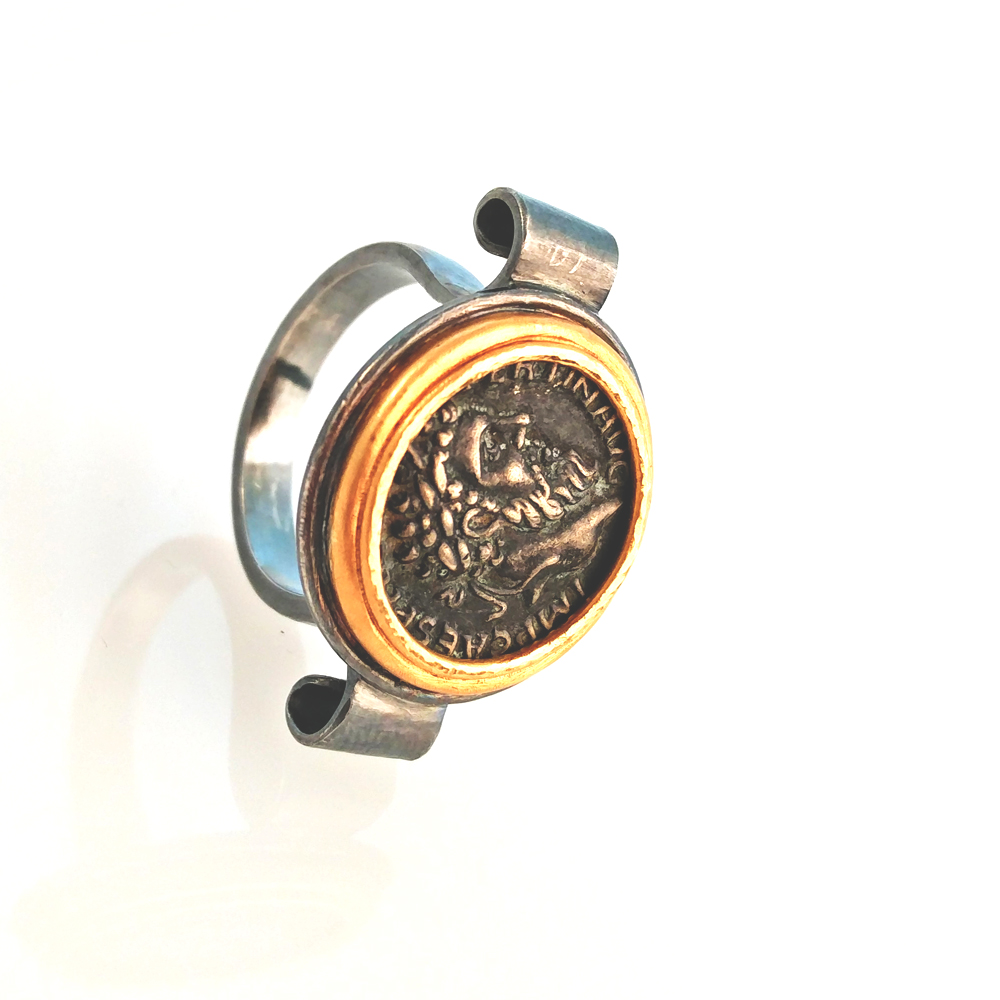 by mehmet unver coin ring 24k gold silver